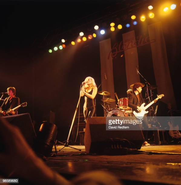 Guitarist Frank Infante singer Debbie Harry and bassist Nigel Harrison of Blondie perform on stage at the Hammersmith Odeon in London England on...