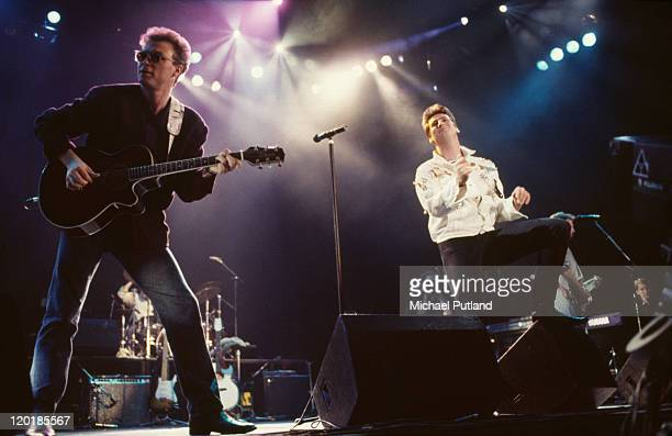 Guitarist Gary Kemp and singer Tony Hadley performing on stage with English pop group Spandau Ballet 1987