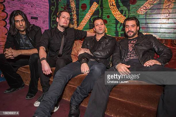 Guitarist Gaurav Bali bassist Luis Espaillat Vocalist / guitarist Taki Sassaris and Drummer Alex Sassaris of Eve To Adam pose backsstage at House of...