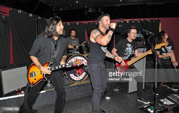 Guitarist Gaurav Bali drummer Alex Sassaris singer Taki Sassaris Luis Espaillat and guitarist Adam Latiff of the rock group Eve To Adam perform live...