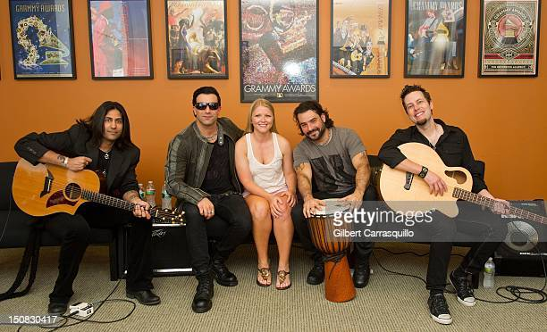Guitarist Gaurav Bali Taki Sassaris Alex Sassaris and Luis Espaillat of Eve to Adam pose with a fan at The Recording Academy Philadelphia Chapter...