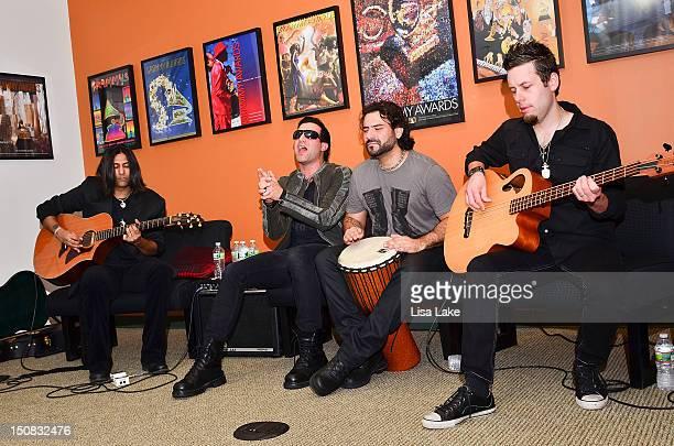 Guitarist Gaurav Bali vocalist Taki Sassaris drummer Alex Sassaris and bass player Luis Espaillat of the band Eve to Adam perform acoustic while...