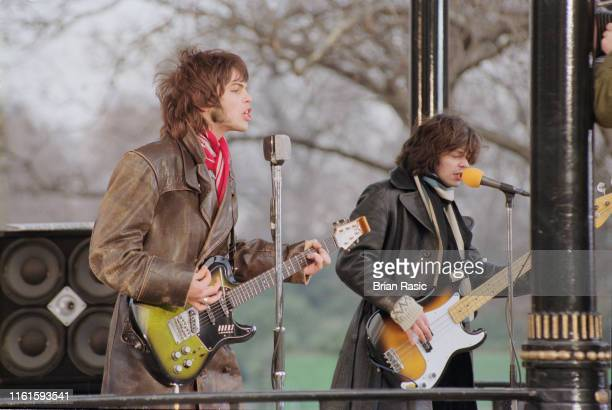Guitarist Gaz Coombes and bass guitarist Mick Quinn of English rock group Supergrass pictured during a video shoot for the band's new single 'Going...