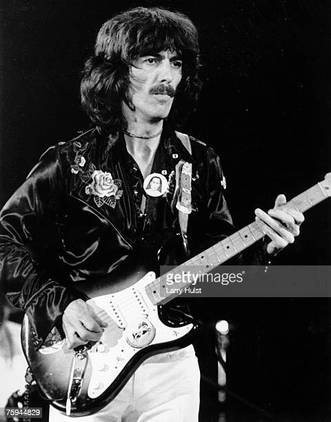 Guitarist George Harrison fomerly of the rock and roll band 'The Beatles' performs onstage with an electric guitar at the Cow Palace on November 6...
