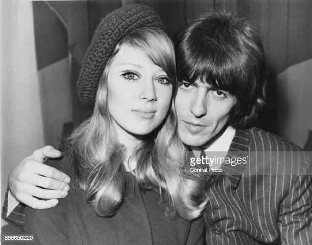 Guitarist George Harrison of British rock group the Beatles with his new bride, model Pattie Boyd, at a press reception at the headquarters of NEMS...