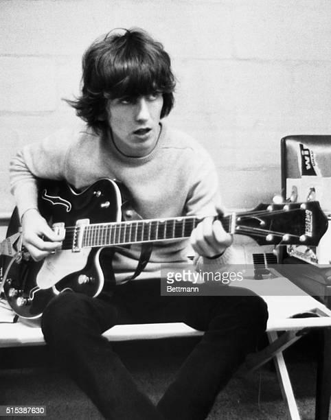 Guitarist George Harrison of The Beatles rehearsing, circa 1967.