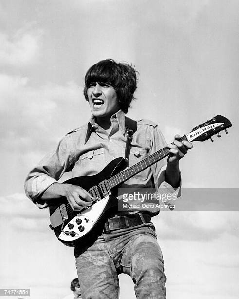 Guitarist George Harrison of the rock and roll band The Beatles performs onstage with a Rickenbacker electric guitar in circa 1966