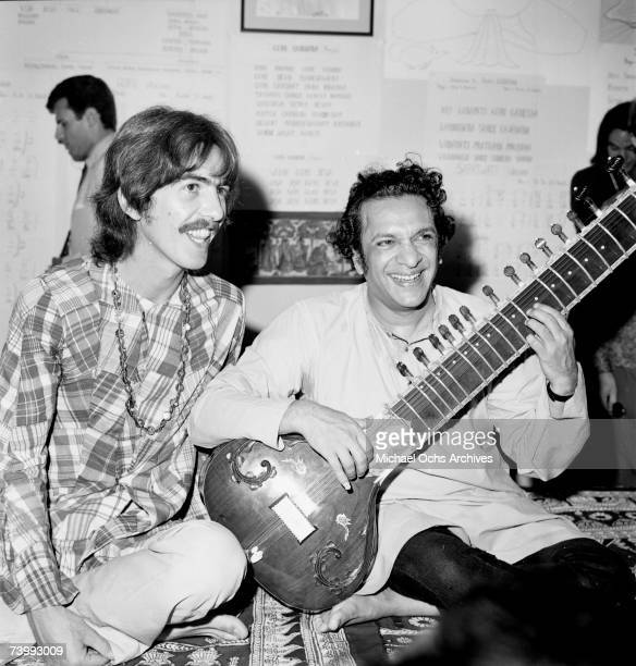 Guitarist George Harrison poses for a portrait with Indian sitar virtuoso Ravi Shankar in circa 1975.