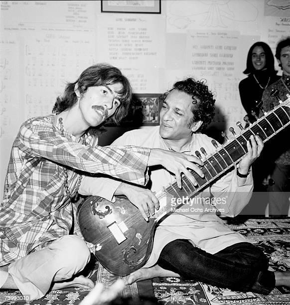 Guitarist George Harrison poses for a portrait with Indian sitar virtuoso Ravi Shankar in circa 1975