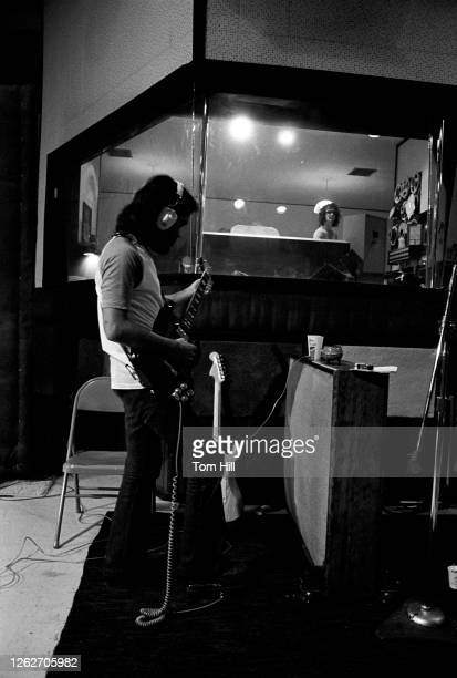 Guitarist Hank Barrio of east LA funky horn band Elijah works on recording Elijah Fanfares for Sounds Of The South Records with producer Al Kooper at...