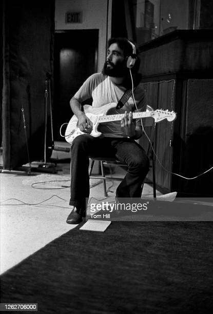 Guitarist Hank Barrio of east LA funky horn band Elijah works on recording Elijah Fanfares for Sounds Of The South Records at Studio I in 1973 in...