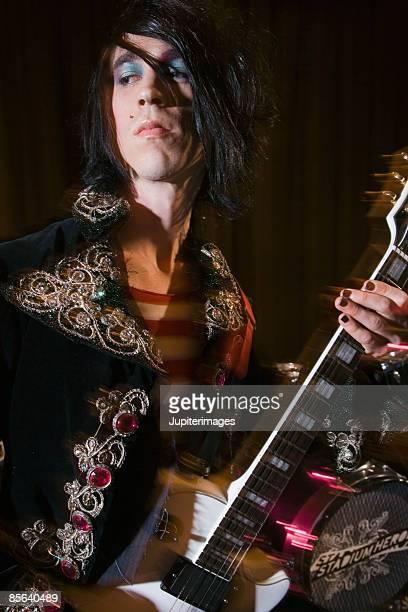 Guitarist in costume and makeup