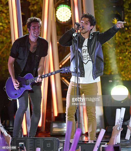 Guitarist Jack Barakat of All Time Low performs with actor and cohost Tyler Posey during the MTV Fandom Fest San Diego ComicCon at PETCO Park on July...