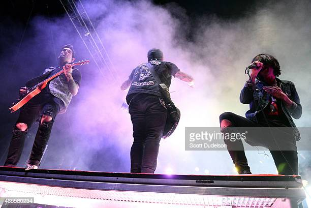 Guitarist Jack Fowler bass player Justin Hills and singer Kellin Quinn of Sleeping with Sirens performs onstage at the Self Help Festival on March 7...