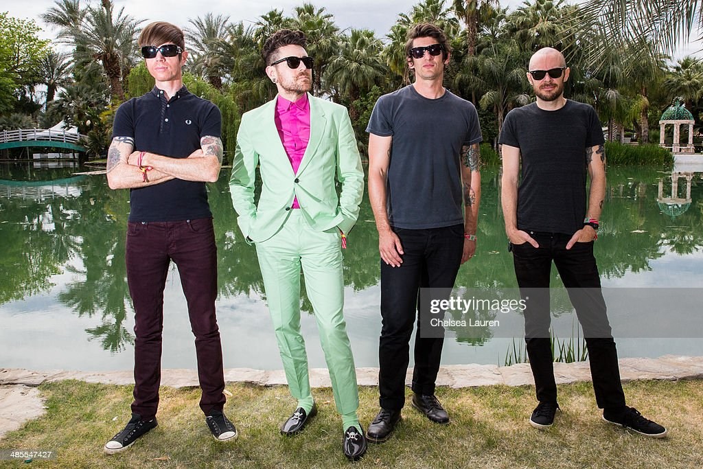Guitarist Jade Puget, Vocalist Davey Havok, drummer Adam Carson and bassist Hunter Burgan of AFI pose backstage during the 2014 Coachella Valley music and arts festival at The Empire Polo Club on April 18, 2014 in Indio, California.