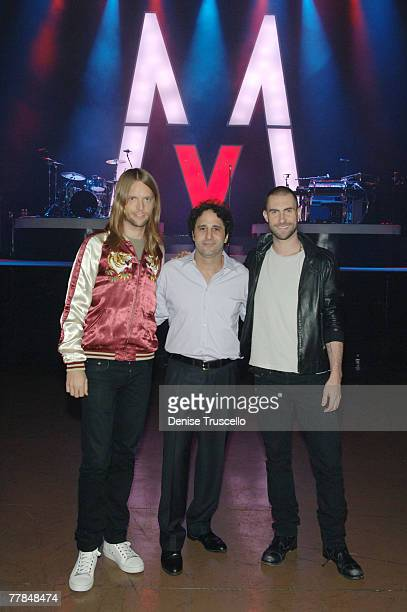 LAS VEGAS NOVEMBER 10 Guitarist James Valentine of Maroon 5 Palms Casino owner George Maloof and singer Adam Levine of Maroon 5 pose for photos at...