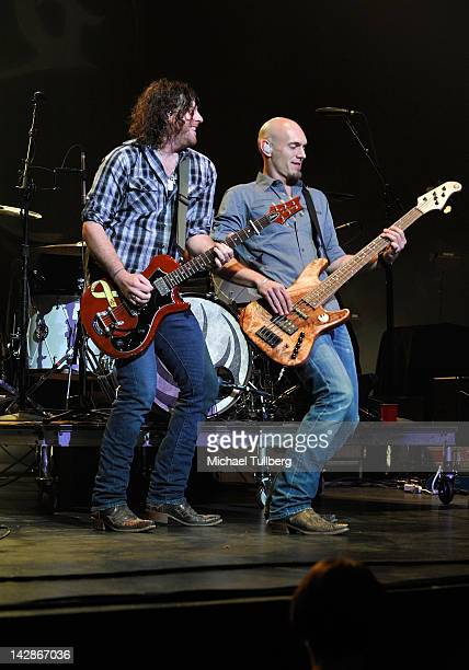 Guitarist James Young and bassist Jon Jones of the Eli Young Band perform live at Nokia Theatre LA Live on April 13 2012 in Los Angeles California