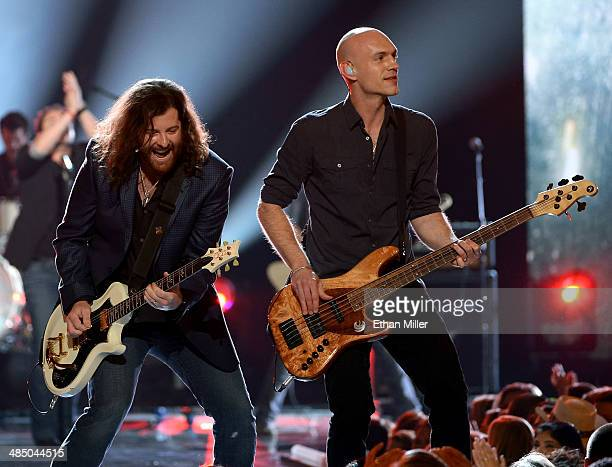 Guitarist James Young and bassist Jon Jones of the Eli Young Band perform during ACM Presents An AllStar Salute To The Troops at the MGM Grand Garden...