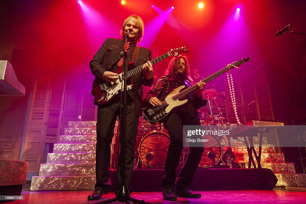 Guitarist James Young and bassist Ricky Phillips of the band Styx performs at the House of Blues on January 17, 2013 in New Orleans, Louisiana.