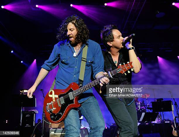 Guitarist James Young and frontman Mike Eli of the Eli Young Band perform during the Academy of Country Music Awards AllStar Jam at the MGM Grand...