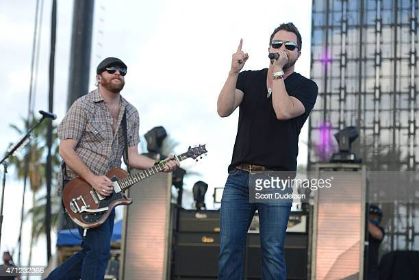 Guitarist James Young and singer Mike Eli of the Eli Young Band performs onstage during day 2 of the Stagecoach Music Festival at The Empire Polo...