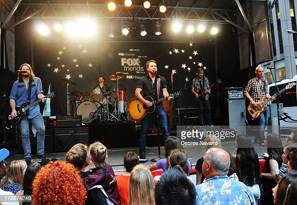 Guitarist James Young drummer Chris Thompson singer Mike Eli and bassist Jon Jones of Eli Young Band perform during FOX Friends All American Concert...