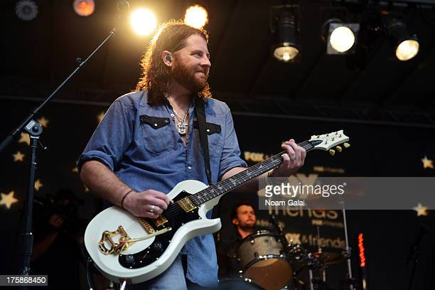 Guitarist James Young of Eli Young Band perform during FOX Friends All American Concert Series outside of FOX Studios on August 9 2013 in New York...