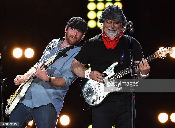 Guitarist James Young of the Eli Young Band and singer/guitarist Randy Owen of Alabama perform onstage during ACM Presents Superstar Duets at Globe...