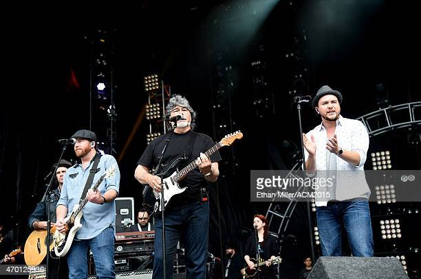 Guitarist James Young of the Eli Young Band singer/guitarist Randy Owen of Alabama and frontman Mike Eli of the Eli Young Band rehearse onstage...
