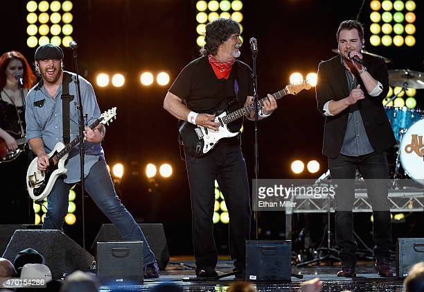 Guitarist James Young of the Eli Young Band singer/guitarist Randy Owen of Alabama and frontman Mike Eli of the Eli Young Band perform onstage during...