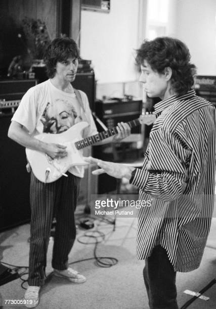 Guitarist Jeff Beck and singer Mick Jagger rehearsing together UK 1987 Beck appeared on Jagger's 1987 solo album 'Primitive Cool'