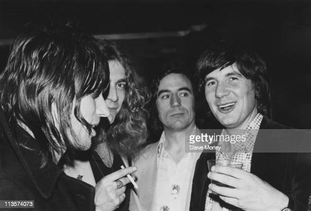 Guitarist Jeff Beck Led Zeppelin singer Robert Plant comedian Terry Jones and comedian Michael Palin attending a Monty Python party in New York USA...