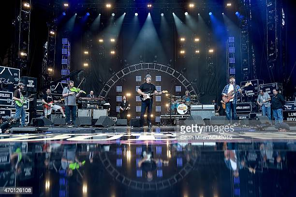 Guitarist Jeff Cook singer/guitarist Randy Owen and bassist Teddy Gentry of Alabama rehearse onstage during ACM Presents Superstar Duets at Globe...