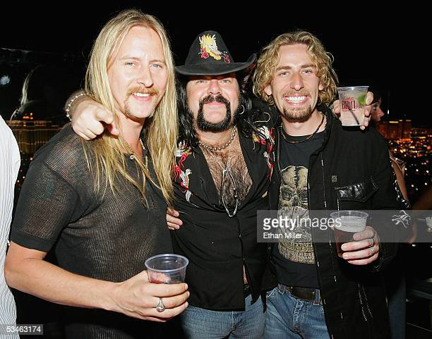 Guitarist Jerry Cantrell former Pantera and Damageplan drummer Vinnie Paul and Nickelback frontman Chad Kroeger pose at a birthday party for Kiss...