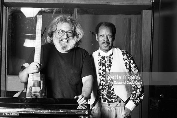 Guitarist Jerry Garcia and composer musician and jazz saxophonist Ornette Coleman pose for a portrait together during a recording session for Mr...