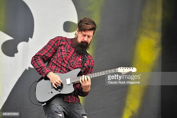 Guitarist Jim Root of American hard rock group Stone Sour performing live on the Main Stage at Download Festival on June 16, 2013.