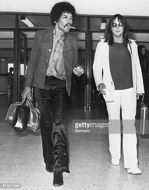 Guitarist Jimi Hendrix and his road manager Eric Barrett arrive at Heathrow Airport on the way to the Isle of Wight Festival