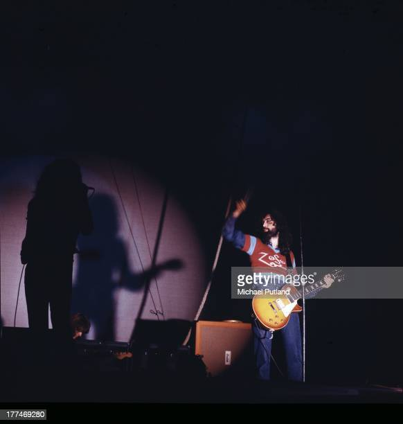 Guitarist Jimmy Page of British rock band Led Zeppelin performing on stage at the Wembley Empire Pool London 23rd November 1971 In the shadows on the...
