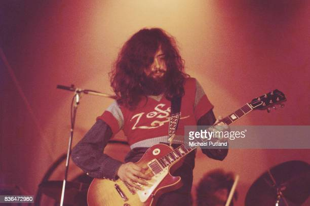 Guitarist Jimmy Page of the English rock group Led Zeppelin perfors at the Empire Pool Wembley London 23rd November 1971