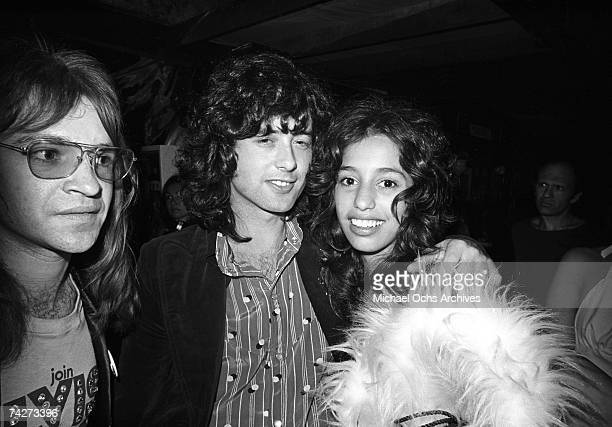 Guitarist Jimmy Page of the rock band 'Led Zeppelin' at Rodney Bingenheimer's English Disco with groupie Lori Maddox and Rodney in June 1972 in Los...