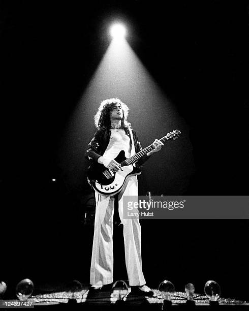 Guitarist Jimmy Page of the rock band Led Zeppelin performs onstage on June 26 1977 at the Forum in Los Angeles California