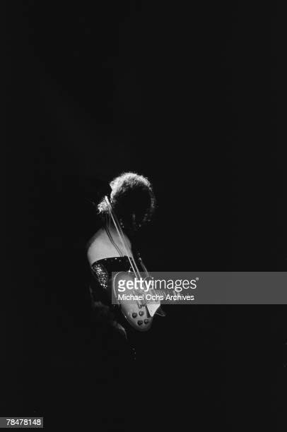 Guitarist Jimmy Page of the rock band 'Led Zeppelin' plays his Gibson Les Paul electric guitar with a bow at the Forum on March 24 1975 in Los...