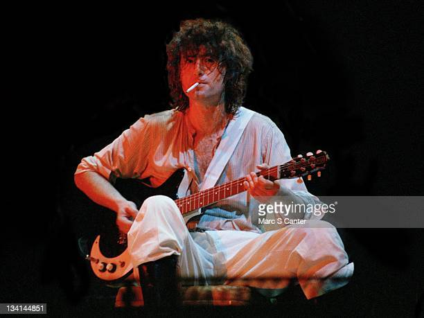 Guitarist Jimmy Page of the rock band 'The Firm' performs onstage smoking a cigarette with a Danelectro electric guitar at the Los Angeles Forum on...