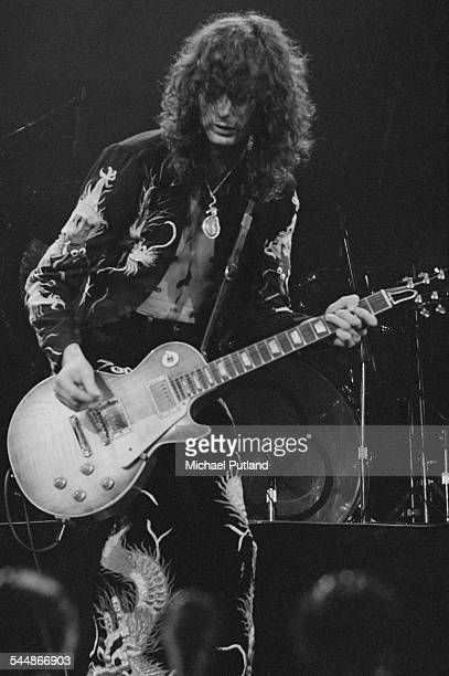 Guitarist Jimmy Page performing with British heavy rock group Led Zeppelin at Earl's Court London May 1975 The band were initially booked to play...