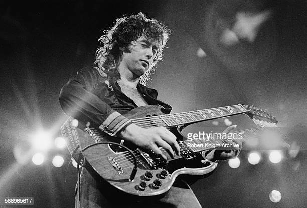 Guitarist Jimmy Page performing with his band 'Led Zeppelin' at the Seattle Coliseum June 1972