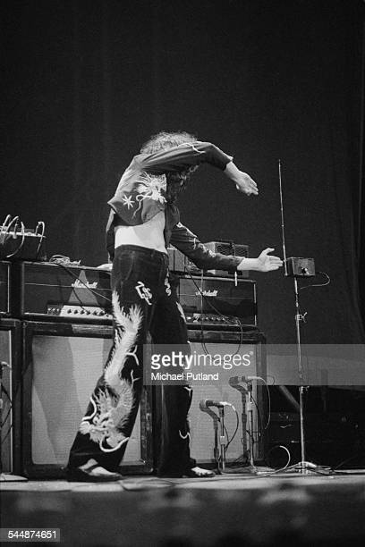 Guitarist Jimmy Page playing a theremin on stage with British heavy rock group Led Zeppelin at Earl's Court London May 1975 The band were initially...