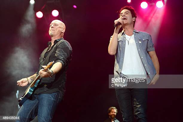 Guitarist Jimmy Stafford and singer Pat Monahan of Train perform onstage during 2015 KAABOO Del Mar at the Del Mar Fairgrounds on September 20, 2015...