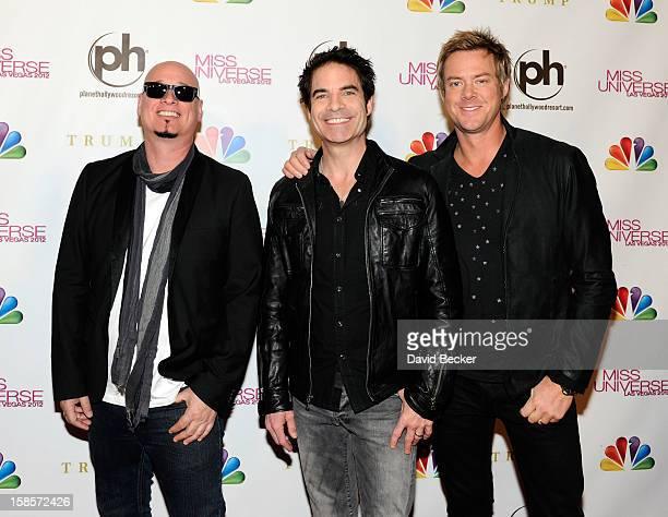 Guitarist Jimmy Stafford singer Pat Monahan and drummer Scott Underwood of the band Train arrive at the 2012 Miss Universe Pageant at Planet...