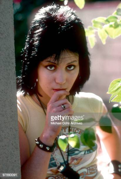 Guitarist Joan Jett of the rock band 'The Runaways' poses for a portrait by her family's home in Canoga Park just outside Los Angeles CA in 1977
