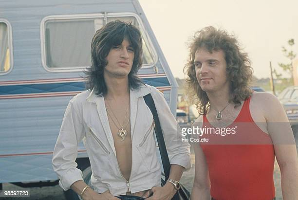 Guitarist Joe Perry and drummer Joey Kramer of Aerosmith off stage in 1976